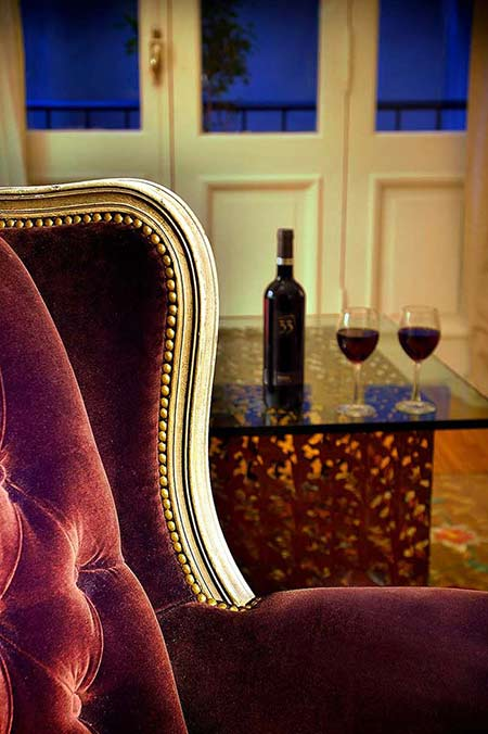 Two Glasses Bottle Malbec Foreground Antique Chair Background Doors Windows